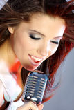 Singer on stage. Girl Singing In Retro Mic on stage Royalty Free Stock Photos