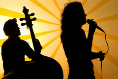A singer and a stand up base. Silhouette royalty free stock photos