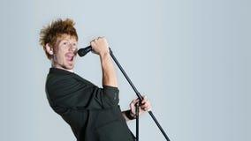 Singer in studio. Super rock star lead singer belts out a high note Stock Images
