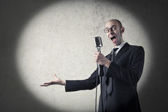 Singer. In suit with a microphone Royalty Free Stock Photo