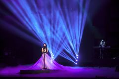 Singer with Ultra Violet stage effect. Liuzhou,China,September 8,2015.The Passing Lane,a singer of local electric rock band performing at the concert.  The Royalty Free Stock Photos