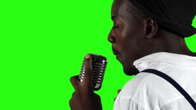 Singer the view from the back holding his microphone and gesticulating hands sings. Green screen. Slow motion. Close up stock video