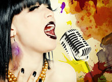 Singer woman with microphone Royalty Free Stock Image