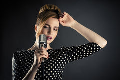 Singer woman with retro microphone Royalty Free Stock Images