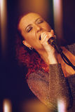 Singer. Woman singing full of soul - Fado singer Royalty Free Stock Image