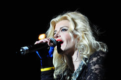 Singer woman singing in microphone Stock Images
