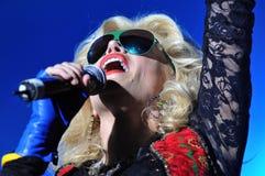 Singer woman singing in microphone Royalty Free Stock Image