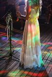 Singer woman on stage. bride sings a song at a wedding party. party lights stock photos