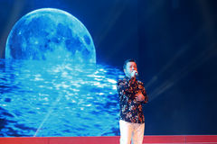 Singer wukezhou sing when moon round Royalty Free Stock Image