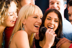 Singers. Portrait of three young attractive women singing together Stock Photography