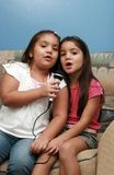 Singers I. Two little girls singing together Stock Images