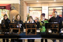 Singers playing holiday music on sidewalks during annual Victorian Streetwalk,Saratoga Springs,NY 2014 Stock Photos