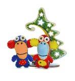 Singes de feutre et arbre de Noël Images stock