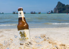 Singha beer on the beach Stock Image