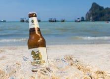 Singha beer on the beach Stock Image