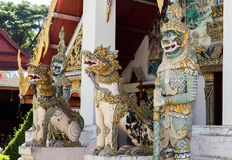 Singha and Giant statue is in Thai temple royalty free stock photos
