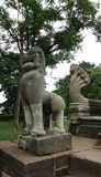 Singha and King of Naga sandstone sculpture Royalty Free Stock Images