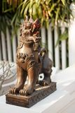 Singha lanna lion statue in Northern Thailand. To the entrance in an ancient temple, near Chian Mai royalty free stock photo