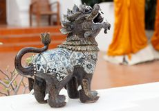 Singha lanna lion statue in Northern Thailand-3. Singha lanna lion statue in Northern Thailand to the entrance in an ancient temple, near Chian Mai stock photography