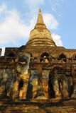 Singha and pagoda. Singha around the wall and pagoda at historic temple Wat Chang Lom thailand Stock Images