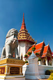 Singha statue and buddhist church Stock Photos