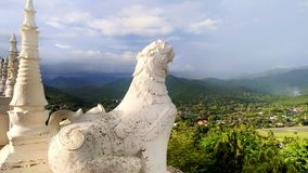 Singha statue and mountain scenery stock image