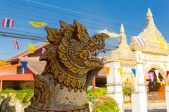 Singha statue is in Thai temple royalty free stock photography