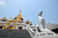 Singha and temple at Wat Trimit Royalty Free Stock Image