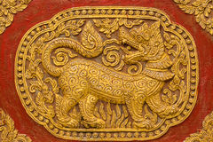 Singha Wall sculpture on Ubosot in Wat Saen Fang Royalty Free Stock Photos