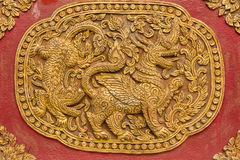 Singha Wall sculpture on Ubosot in Wat Saen Fang , Chiangmai Royalty Free Stock Photography