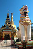 Singha is white lion guardians in temple,Myanmar. Royalty Free Stock Image