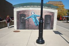 Singin` in the rain mural Ann Arbor Michigan USA. Near the transit hub and bus station royalty free stock photos