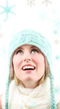 Singin in the snow. Beautiful blond watches snowflakes falling Stock Images