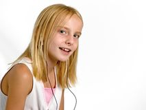 Singing. Photo of a young girl singing while listening to headphones Royalty Free Stock Photos