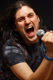 Singing. This picture represents a man singing Royalty Free Stock Photography