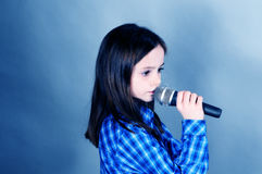 Singing. Cute girl singing a sentimaental song Stock Photos