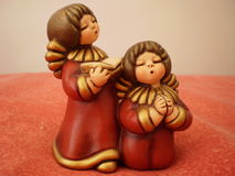 Singing Angels. A miniature of two singing angels Royalty Free Stock Images