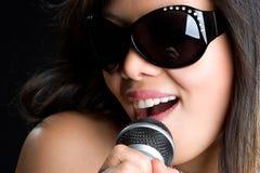 Singing Asian Woman. Pretty karaoke asian woman singing Royalty Free Stock Photos