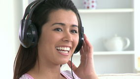 Singing asian woman listen to music stock video