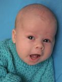 The singing baby. (Small depth of sharpness royalty free stock photo