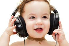 Singing baby wearing headphones Stock Image
