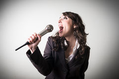 Singing beautiful young businesswoman Stock Image
