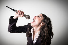 Singing beautiful young businesswoman Stock Photography