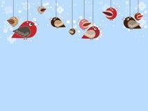 Singing birds with beatiful falling snowflakes Stock Photos