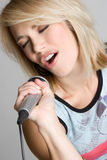 Singing Blond Girl Royalty Free Stock Photography