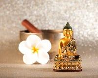 Singing Bowl and Buddha statue. stock photo