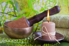 Singing bowl and a candle - spa decoration Royalty Free Stock Image