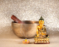 Singing Bowl, incense sticks and Buddha statue. royalty free stock photo