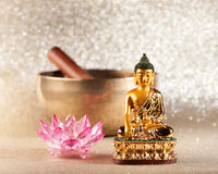 Singing Bowl, lotus flower and Buddha statue. stock images