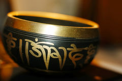Singing bowl for meditation. Black singing bowl for meditation Royalty Free Stock Images